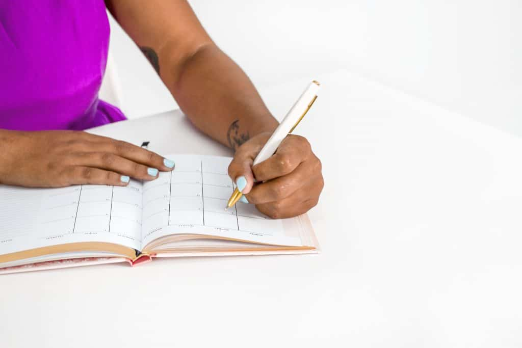 woman working on worksheet
